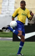 BRAZILIAN STRIKER AMOROSO CONTROLS THE BALL.