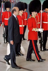 French Prime Minister Alain Juppe inspects an Honour Guard during arrival ceremonies in Ottawa June ..