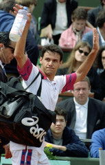 Renzo Furlan of Italy salutes the public as he leaves the court after winning his match against Scot..