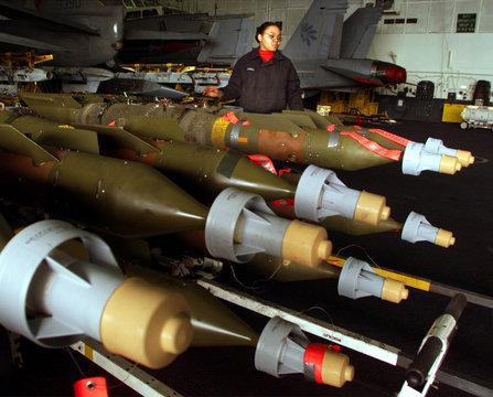 AVIATION ORDNANCE TECHNICIAN CHECKS LASER GUIDED BOMBS.