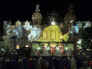 A light show  celebrating the year 2000 and  Prince Rainier's fifty years of reign lights up the fac..