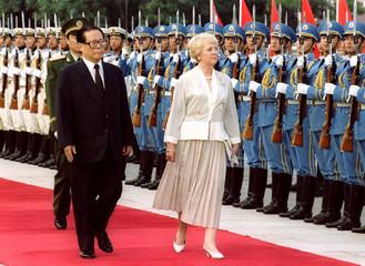 China's President Jiang Zemin (L) escorts Iceland's President Vigdis Finnbogadottir (R) as they insp..
