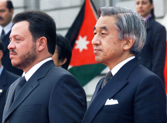 Jordanian King Abdullah Il Bin Al Hussein (L) and Emperor Akihito of Japan stand at attention as the..