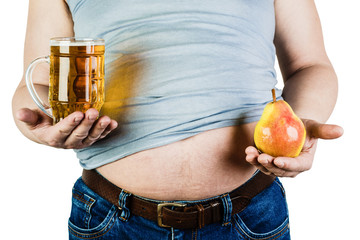 A man with a large belly,holding a glass of beer and a pear. The choice between fruit and beer.