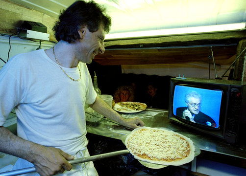 """Gerard the """"Pizzaiolo"""" in his pizza van watches Socialist presidential party candidate Lionel Jospin.."""