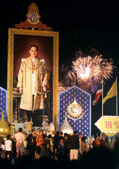 FIREWORKS EXPLODE OVER A PORTRAIT OF THE THAI KING ON HIS BIRTHDAY.