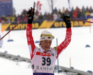 MARIA THEURL OF AUSTRIA CELEBRATES THIRD PLACE IN THE 15 KM CROSS COUNTRY EVENT.