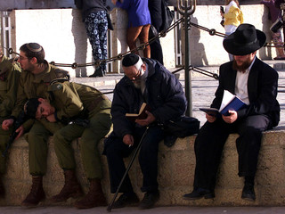 SOLDIER SLEEPS NEAR WESTERN WALL AT OLD CITY IN JERUSALEM.