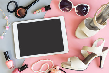 women cosmetics with tablet and fashion accessories