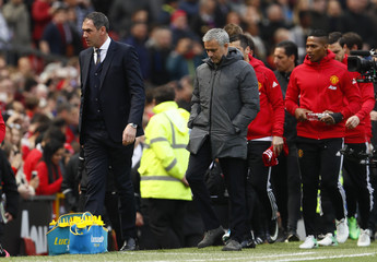 Swansea City manager Paul Clement and Manchester United manager Jose Mourinho before the match