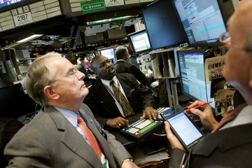 Traders work on the floor at the New York Stock Exchange in New York