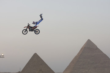 A biker performs in front of the Great Giza pyramids during Red Bull Fighters International Freestyle Motocross 2009 Exhibition Tour on the outskirts of Cairo