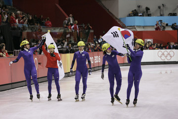 South Korean skaters celebrate Gold Medal after the woman's 3000 metres short track speed skating relay A-final at the Winter Olympic Games