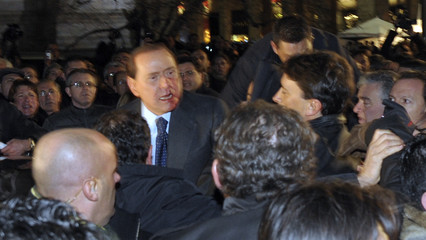 Blood covers part of the face of Italy's PM Berlusconi after he was attacked in downtown Milan