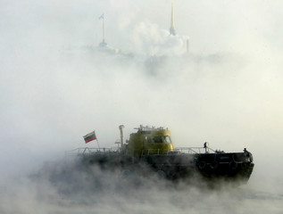An icebreaker cleans ice on the Neva River in central St.Petersburg during freezing temperatures