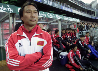 CHINA'S COACH SHEN XIANG FU LOOKS ON IN HONG KONG.