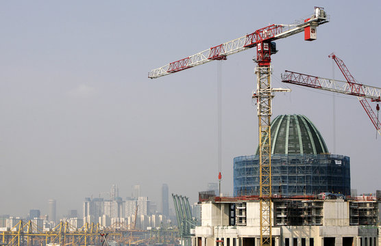 Dome of under-construction Resorts World Sentosa casino is pictured with city skyline in the background in Singapore