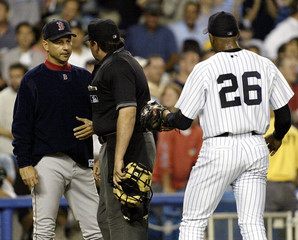 Umpire reverses call from home run to foul ball on Red Sox batter Ramirez against the Yankees in New York.