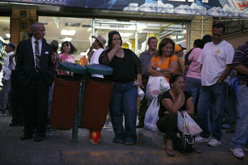 Commuters wait for the opening of the Paso del Norte international border crossing bridge during an operation after a bomb threat in the border city of Ciudad Juarez