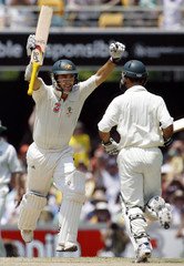 Australia's Langer celebrates reaching his century during the fourth day's play of the first Ashes cricket test against England in Brisbane