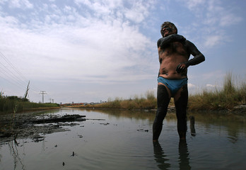 Man smears himself with mud from the Bourgas salt-works lake in Bulgaria