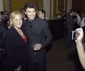 """U.S. Senator Mary Landrieu has her picture taken with actor Anson Mount during a """"Tribute to the 110th Congress"""" in Washington"""
