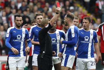 Chesterfield's Dan Gardner is shown a red card