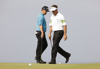 Stuart Appleby and Greg Chalmers, both from Australia, walk past their balls at the green of the third hole during the second round of the 2009 Australian Open golf tournament at the New South Wales course in Sydney