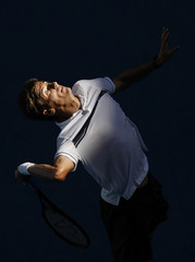 Spain's Robredo serves to Roddick of the U.S. during their match at the Australian Open tennis tournament in Melbourne