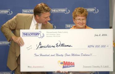 GERALDINE WILLIAMS RECEIVES CHECK FOR MEGA MILLIONS LORRETY WINNINGS.