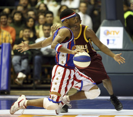 Herbert Lang of Harlem Globetrotters drives to basketball during exhibition game with NY Nationals in Istanbul