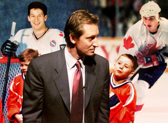 WAYNE GRETZKY WITH PICTURES OF CANADIAN OLYMPIC HOCKEY TEAM MEMBERS.