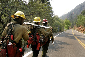 Big Bear Hotshots patrol along Highway 89A as they work to contain brushfires in Oak Creek Canyon near Sedona