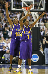 LSU Thomas and Mitchell celebrate win over Duke in their NCAA Regional basketball game in Atlanta