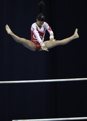 Switzerland's Lucia Taccelli competes on the uneven bars during a qualification competition at the World Cup in Artistic Gymnastics in Moscow