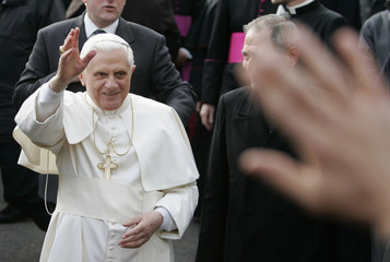 Pope Benedict XVI waves to faithful as he arrives to visit Caritas cantine for homeless in downtown Rome