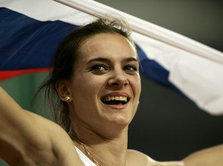 Yelena Isinbayeva of Russia celebrates gold medal and world record in pole vault at Athens 2004 ...
