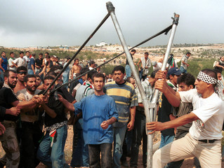 PALESTINIANS USE A GIANT SLING AGAINST ISRAELI FORCES ON THE BORDER WITH ISRAEL IN SOUTH LEBANON.