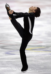 Figure skater Weir of the US skates during a practice session in Turin