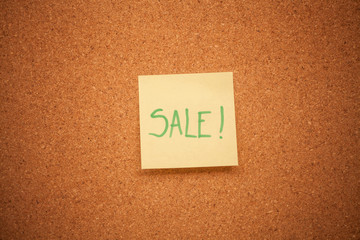 Sale note on cork board