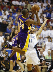 Los Angeles Lakers Bryant is fouled on a three-point shot by Orlando Magic Lee during Game 3 of their NBA Finals basketball game in Orlando
