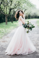 Portrait of beautiful bride in the park