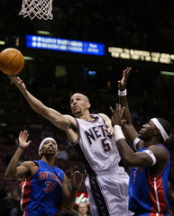 NEW JERSEY NETS KIDD SCORES PAST DETROIT PISTONS HAMILTON AND WALLACE.