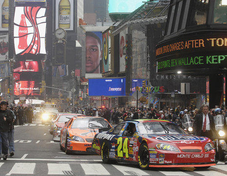Fans line the street as the top ten NASCAR drivers celebrate the end of their season with a lap through Times Square in New York