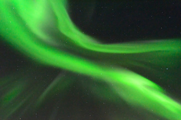 The Aurora in the sky at night .