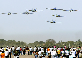Tucano airplanes of Fumaca squadron from Brazil's Air Force perform during celebrations in Santa Cruz