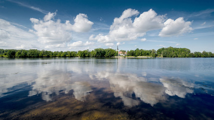 Landscape photography. Cloud reflections in the river.