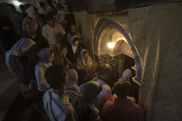 Worshippers gather to enter the grotto at Church of Nativity in Bethlehem