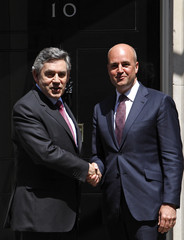 Britain's PM Brown greets his Swedish counterpart Reinfeldt on the doorstep of 10 Downing Street in London