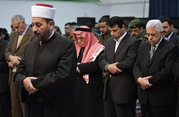 Palestinian President Mahmoud Abbas attends Eid al-Adha holiday prayers at his headquarters in the West Bank city of Ramallah